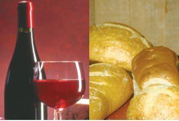 Imagem com vinho e pão.