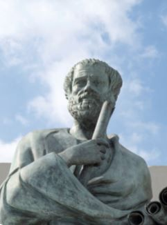 Aristóteles com um pergaminho na mão.