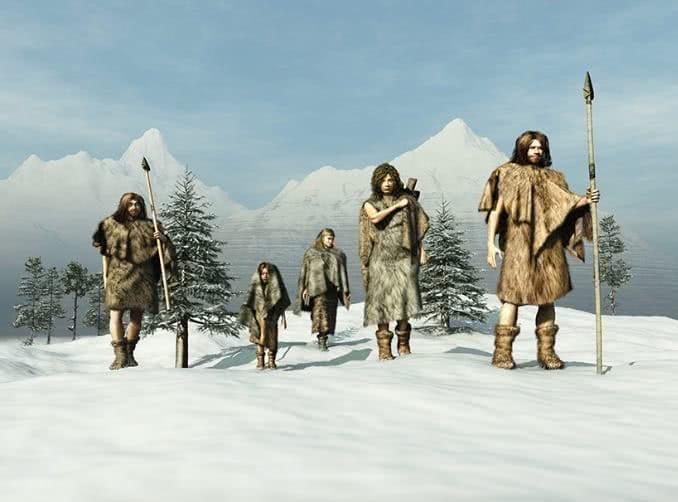 Homens da Era do Gelo caminhando sobre a neve.